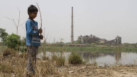 The son of small farm holder Mohammad Mujabir stands by the Yamuna River in New Delhi on May 8, 2019.