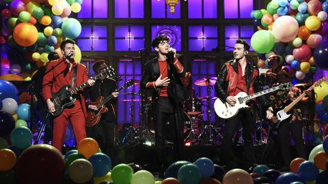 """The Jonas Brothers performed their new singles """"Sucker"""" and """"Cool"""" before throwing it back to """"Burnin' Up"""" on """"Saturday Night Live."""""""