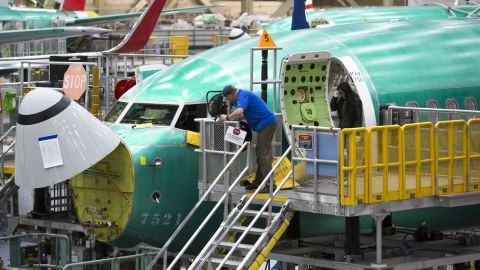 Employees work on Boeing 737 MAX airplanes at the Boeing Renton Factory in Renton, Washington on March 27, 2019. - Embattled aviation giant Boeing will do all it can to prevent future crashes like the two that killed nearly 350 people in recent months, a company official said. Boeing gathered hundreds of pilots and reporters at its factory to unveil a fix to the flight software of its grounded 737 MAX aircraft, which has been implicated in the latest air disasters. (Photo by Jason Redmond / AFP)        (Photo credit should read JASON REDMOND/AFP/Getty Images)