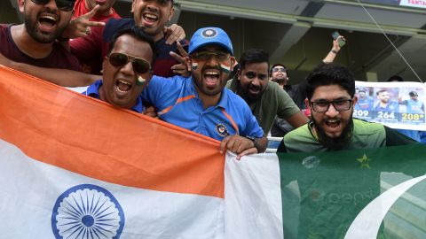 Indian and Pakistan cricket fan cheer in support of their national team during the one day international (ODI) Asia Cup cricket match between Pakistan and India at the Dubai International Cricket Stadium in Dubai on September 19, 2018. (Photo by Ishara S. KODIKARA / AFP)        (Photo credit should read ISHARA S. KODIKARA/AFP/Getty Images)