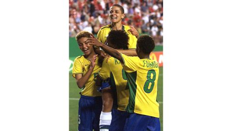 Sissi (C) is engulfed by teammates after the quarterfinal victory over Nigeria.