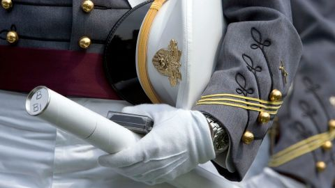 WEST POINT, NY - MAY 26:  A cadet holds his diploma and cap during the graduation ceremony at the U.S. Military Academy May 26, 2007 at Michie Stadium in West Point, New York. The almost 1,000 cadets who graduated were the first to enter the U.S. Military Academy after the start of the war in Iraq in March 2003.  (Photo by Stephen Chernin/Getty Images)
