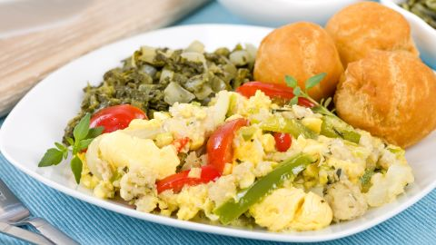 <strong>Jamaica: </strong>Ackee, a delicately sweet pear-shaped fruit, is sautéed with salt cod, tomatoes, garlic, chilies and onion in a breakfast scramble that brings together sweet, salty, and spicy for a one-of-a-kind island taste.