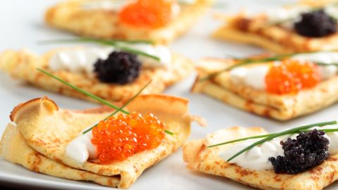 <strong>Russia: </strong>Blinis with red and black caviar on a plate may sound indulgent, but it's really just a classic breakfast here.