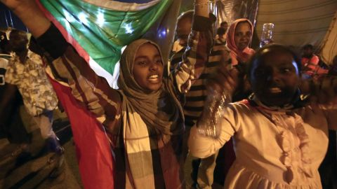Sudanese protestors celebrate after an agreement was reached with the military council to form a three-year transition period for transferring power to a full civilian administration.