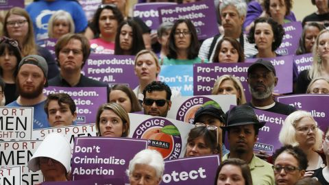 """Abortion rights supporters stand during a news conference by Presidential candidate Sen. Kirsten Gillibrand, D-N.Y., at the Georgia State Capitol in Atlanta on Thursday, May 16, 2019 to discuss abortion bans in Georgia and across the country. Georgia was the fourth state this year to pass anti-abortion """"heartbeat"""" legislation, but Democratic presidential candidates have taken aim at the state's law banning most abortions after six weeks that's set to go into effect in January. (Bob Andres/Atlanta Journal-Constitution via AP)"""