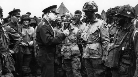 """US Gen. Dwight D. Eisenhower, supreme commander of the Allied forces, gives the order of the day to paratroopers in England. """"Full victory — nothing else"""" was the command just before they boarded their planes to participate in the first wave. The invasion — code-named Operation Overlord — had been brewing for more than two years."""