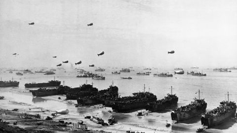Landing craft and a fleet of protection vessels approach Omaha Beach.