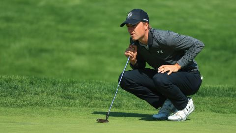 Jordan Spieth of the United States lines up a putt on the 16th green during the second round of the US PGA Championship. At the end of the round, Spieth was tied second with Australian Adam Scott.