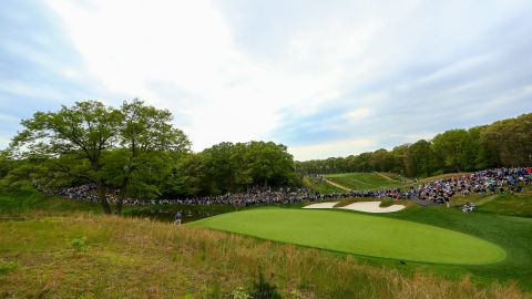 Fans line up near the the eighth green during the second round.