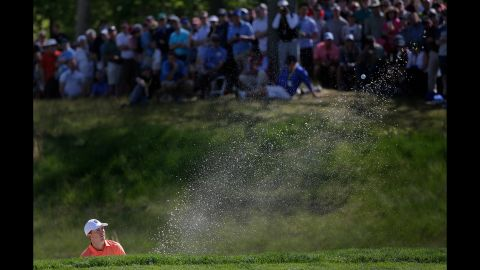 Jordan Spieth hits out of a bunker onto the fifth green during the third round of the PGA Championship golf tournament on Saturday, May 18.