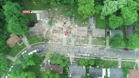 An overhead image shows the remnants of a home strewn across the neighborhood in Jeffersonville, Indiana, on Sunday.