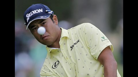 Japan's Hideki Matsuyama of Japan chips onto the 13th green during the final round of the PGA Championship.