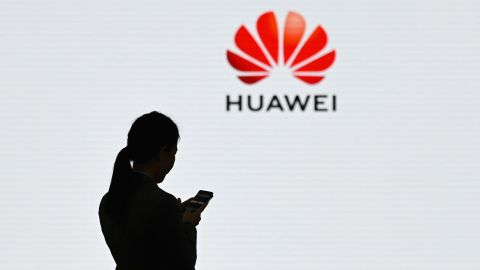 """A staff member of Huawei uses her mobile phone at the Huawei Digital Transformation Showcase in Shenzhen, China's Guangdong province on March 6, 2019. - Chinese telecom giant Huawei insisted on March 6 its products feature no security """"backdoors"""" for the government, as the normally secretive company gave foreign media a peek inside its state-of-the-art facilities. (Photo by WANG ZHAO / AFP)        (Photo credit should read WANG ZHAO/AFP/Getty Images)"""