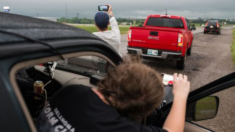 """Brandon Alexander, 18; and Daniel Brown, 48, are local storm chasers who followed the storm to Perry, Oklahoma. """"We've only been doing this for about a year,"""" Brown said May 20."""