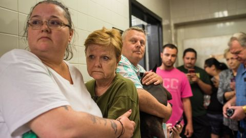 Scared travelers huddle in the back of a gas station for about 15 minutes as doors shook and heavy winds and rain rattled the small building on Monday, May 20.