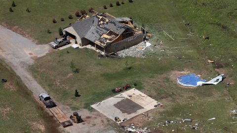 A house damaged by a tornado is seen in Mangum, Oklahoma, Tuesday, May 21.