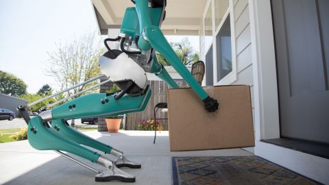 Ford's robot places a package in front of a door.