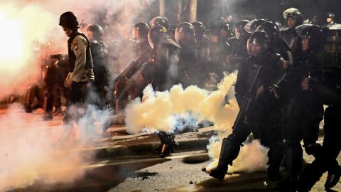 Indonesian police shoot tear gas to disperse protesters during a demonstration outside the Elections Oversight Body in Jakarta on May 22, 2019.