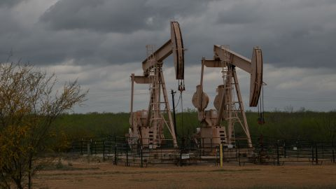 Pump jacks at an oil extraction site on March 12, 2019, in Cotulla, Texas. (Photo by Loren ELLIOTT / AFP)        (Photo credit should read LOREN ELLIOTT/AFP/Getty Images)