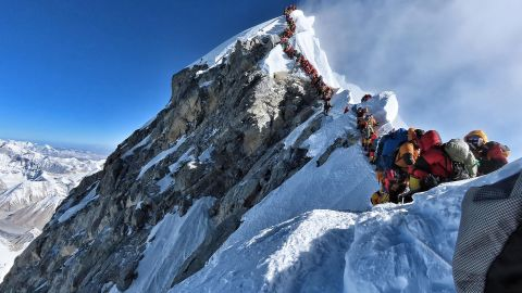 A handout photo taken on May 22, 2019 and released by climber Nirmal Purja's Project Possible expedition shows heavy traffic of mountain climbers lining up to stand at the summit of Mount Everest. Many teams had to line up for hours on May 22 to reach the summit, risking frostbites and altitude sickness, as a rush of climbers marked one of the busiest days on the world's highest mountain.
