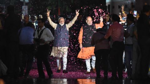 """Indian Prime Minister Narendra Modi (L) flashes the victory sign next to president of the ruling Bharatiya Janata Party (BJP) Amit Shah as they celebrate their victory in India's general elections at the party headquarters in New Delhi on May 23, 2019. - Hindu nationalist Prime Minister Narendra Modi claimed victory on May 23 in India's general election and vowed an """"inclusive"""" future, with his party headed for a landslide win to crush the Gandhi dynasty's comeback hopes. (Photo by Money SHARMA / AFP)        (Photo credit should read MONEY SHARMA/AFP/Getty Images)"""