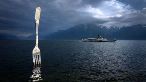 <strong>Lake Geneva, Switzerland:</strong> A paddle steamer sails by a giant fork sculpture designed by Swiss artist Jean-Pierre Zaugg.