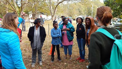 Lakewood-Browns Mill neighbors get ready for a guided hike during the Food Forest Festival.