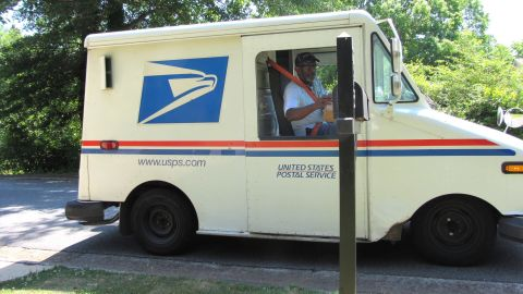 Floyd Martin delivers mail on his last day working for the US Postal Service before retirement.
