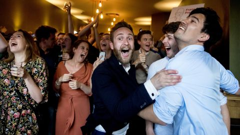 Members of the Labour Party (PvdA) celebrate after the exit polls were announced.
