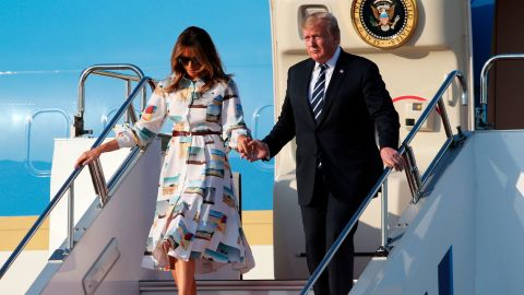 President Trump and First Lady Melania Trump disembark from Air Force One.