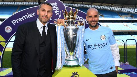 Manchester City chairman Khaldoon Al Mubarak (left) poses with Pep Guardiola after winning EPL title.