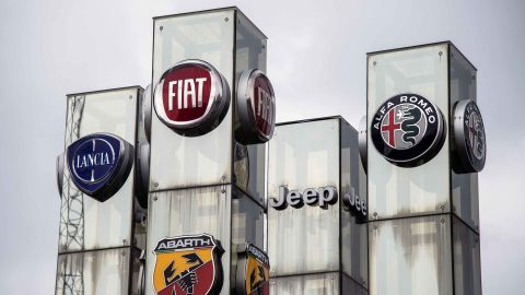 A picture taken on May 27, 2019 at a car dealer in Turin shows the logos of Lancia, Fiat, Abarth Jeep and Alfa Romeo auto makers, brands of Fiat Chrysler Automobiles (FCA) company. - French and Italian-US auto giants Renault and Fiat Chrysler are set to announce talks on an alliance, with a view to a potential merger, informed sources said on May 26, 2019. (Photo by MARCO BERTORELLO / AFP)        (Photo credit should read MARCO BERTORELLO/AFP/Getty Images)