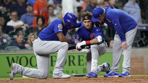 Cubs outfielder Albert Almora Jr. is consoled after he hit a foul ball that struck a fan.