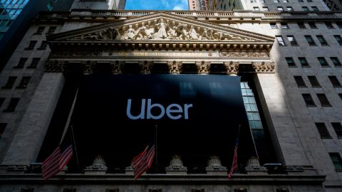 An Uber banner adorns the facade of the New York Stock Exchange ahead of the ride sharing company's IPO (Initial Public Offering), on May 10, 2019, in New York. (Photo by Don Emmert / AFP)        (Photo credit should read DON EMMERT/AFP/Getty Images)