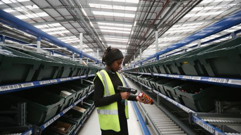 MILTON KEYNES, ENGLAND - JANUARY 03: A worker scans an item in the giant semi-automated distribution centre where the company's partners process the online orders for the John Lewis department store on January 3, 2013 in Milton Keynes, England. John Lewis has published their sales report for the five weeks prior December 29, 2012 which showed online sales had increased by 44.3 per cent over the same period in 2011. Purchases from their website Johnlewis.com now account for one quarter of all John Lewis business.  (Photo by Oli Scarff/Getty Images)