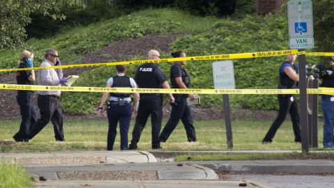 Police work the scene where 12 people were killed during a mass shooting at the Virginia Beach city public works building, on Friday, May 31.