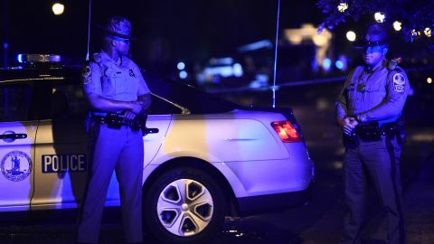 Police officers block access to the Virginia Beach municipal center, the site of a mass shooting, in Virginia Beach, Virginia in the late hours of May 31, 2019.
