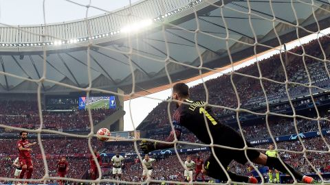 Salah's penalty kick sneaked under Spurs goalkeeper Hugo Lloris.