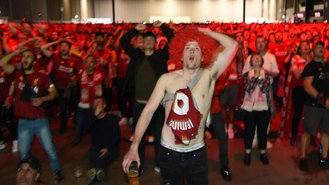 Liverpool supporters in the M&S Bank Arena in Liverpool react to Salah's goal.