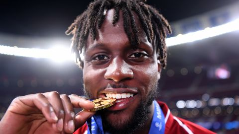 Divock Origi of Liverpool -- who came on to score the second goal -- celebrates with his medal after the match.