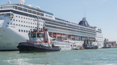 VENICE, ITALY - JUNE 02: A damaged tourist river boat can be seen docked next to a cruise liner after they collided on June 02, 2019 in Venice, Italy. At least four people were injured after the cruise liner MSC Opera lost control and smashed into a Venice dock earlier in the day. (Photo by Simone Padovani/Awakening/Getty Images)