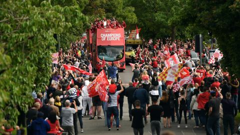 Liverpool fans line the streets as Liverpool's English midfielder Jordan Henderson holds the European Champion Clubs' Cup trophy on Sunday.