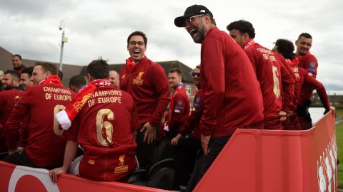 Liverpool's German manager Jurgen Klopp shares a laugh at the start of the parade.