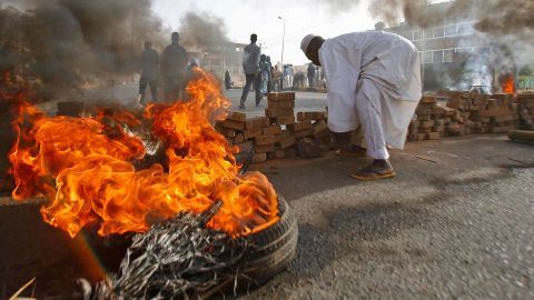 """Protesters block a street with bricks and burning tires as military forces attempt to disperse a sit-in outside the army headquarters in Khartoum, Sudan, on Monday, June 3. More than <a href=""""https://edition.cnn.com/2019/06/05/africa/sudan-death-toll-intl/index.html"""" target=""""_blank"""">100 protesters were killed</a> when the military opened fire to break up the sit-in, according to a local doctors' union."""