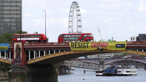"Amnesty International installs ""Resist Trump"" banners on Vauxhall Bridge in London."
