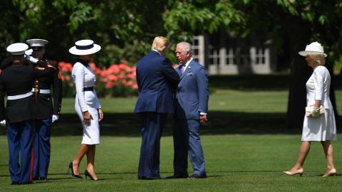 Prince Charles greets Trump as he steps off Marine One at Buckingham Palace.