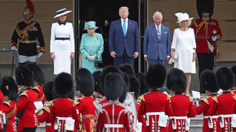 The US National Anthem is played during a welcoming ceremony at Buckingham Palace. From left are Melania Trump, the Queen, Trump, Charles and Camilla.