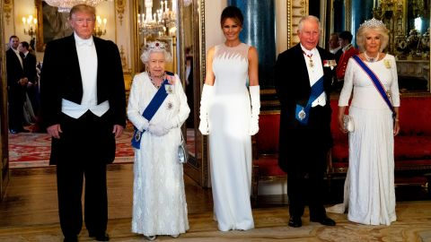 """Trump stands next to Queen Elizabeth II before <a href=""""https://www.cnn.com/2019/06/04/politics/donald-trump-queen-elizabeth-state-banquet/index.html"""" target=""""_blank"""">a state banquet at Buckingham Palace</a> on Monday, June 3. Joining them are Melania Trump, Prince Charles and Camilla."""