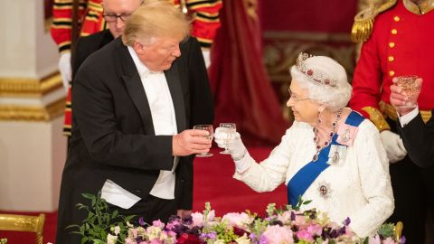 Britain's Queen Elizabeth II (R) raises a glasses with US President Donald Trump during a State Banquet in the ballroom at Buckingham Palace in central London on June 3, 2019, on the first day of the US president and First Lady's three-day State Visit to the UK. - Britain rolled out the red carpet for US President Donald Trump on June 3 as he arrived in Britain for a state visit already overshadowed by his outspoken remarks on Brexit. (Photo by Dominic Lipinski / POOL / AFP)        (Photo credit should read DOMINIC LIPINSKI/AFP/Getty Images)
